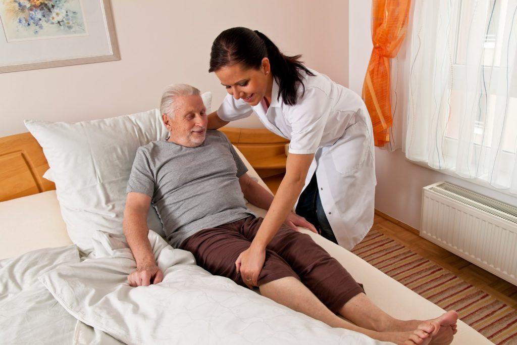 Elderly patient with his nurse